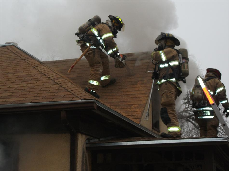 Firefighters on the Roof of  Structure  on Adams Street