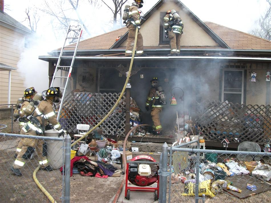 Firefighters Work to Extinguish Structure Fire on Adams Street